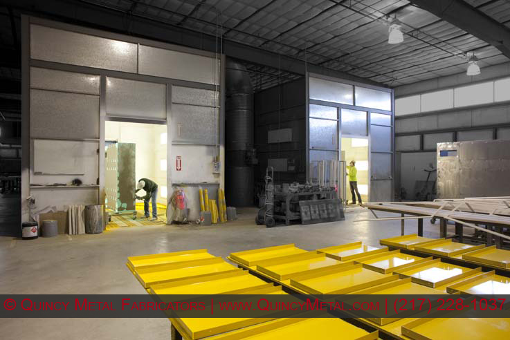 Quincy Metal Fabricators' two down draft paint booths and prep area