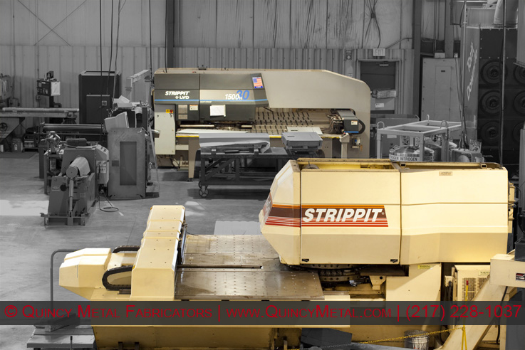 Two of Quincy Metal Fabricator's 4 CNC punch presses, A Strippit 1500 H30 and 1250 S