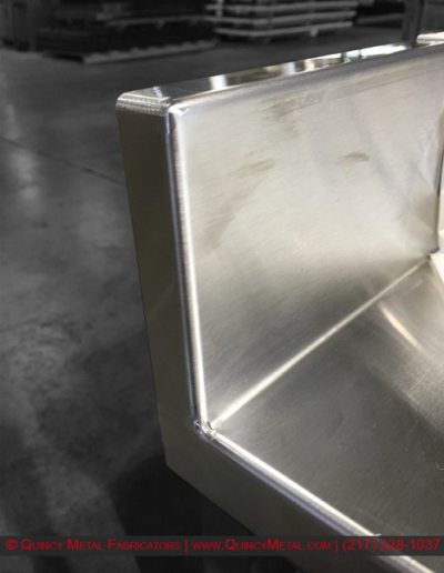 Superior stainless steel welding shown on a countertop piece, from Quincy Metal Fabricators' welding department
